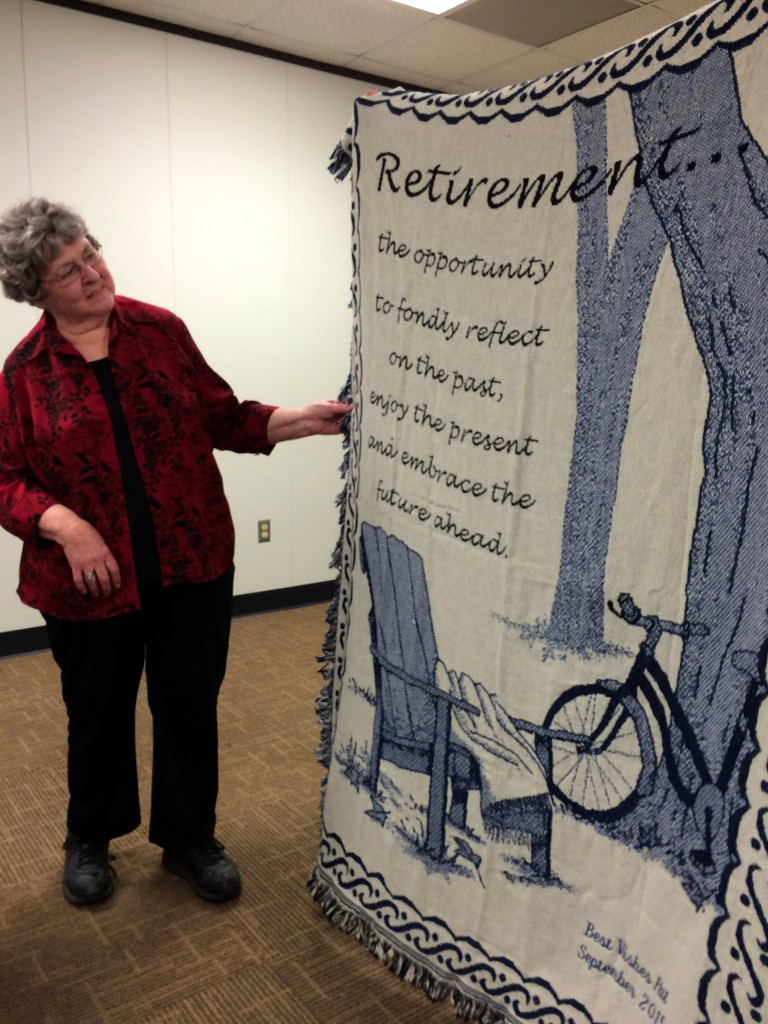 Photo of Pat Brown and retirement blanket