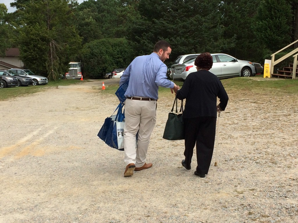 Photo of Food Lion associate carrying grocery bags
