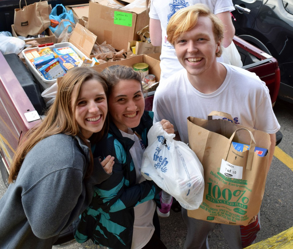 Photo of Sanderson students and their food drive donations