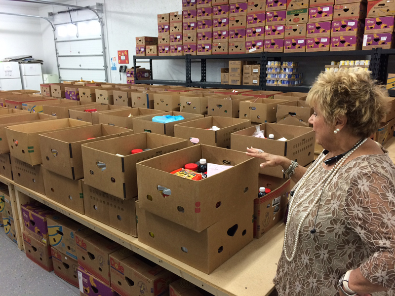 Photo of Dianne Andrews in food pantry