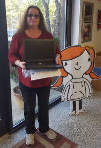 Sandy Marsh, Agency Director of Southern Mission Ministries with her newly obtained discounted computer.