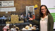 Upon her visit to the Food Bank's new Capital Blvd. facility, Roberta points to herself in a photo from the 1997 grand opening of the Tarheel Drive facility.