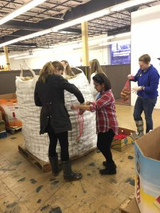 St. Mary's Students bag potatoes on MLK Day at our Durham Branch