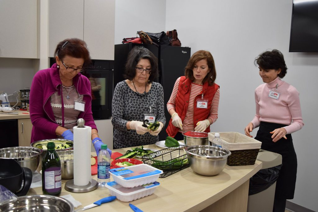 American Turkish Association volunteers prepare healthy dishes in the Food Bank's Allscripts Teaching Kitchen