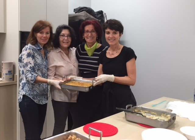 American Turkish Association volunteers cook together in the Allscripts Teaching Kitchen