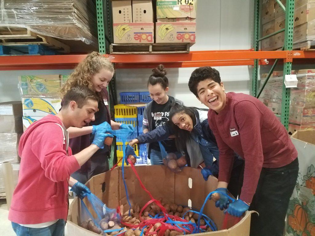 Franklin Academy volunteers sorting potatoes