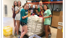 Food Bank Club members at the Food Bank's Raleigh Branch warehouse sorting potatoes into family-sized bags.